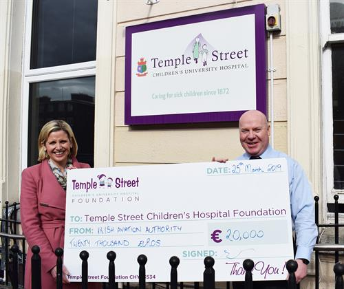 IAA Temple Street cheque handover Emma Barrett and Peter Kearney mid res